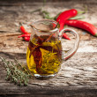 Olive oil with spice and herbs — Stock Photo #34470581