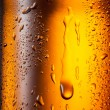 Water drops texture on the bottle of beer. Abstract background — Stock Photo #34475023