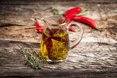 Olive oil with spice and herbs — Stock Photo
