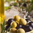 Green and black olives with leaves — Stock Photo #34509375