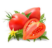 Fresh tomatoes with leaves isolated on white — Stock Photo