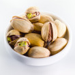 Pistachio. Heap of nuts isolated on white background — Stock Photo