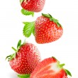 Stock Photo: Falling strawberries. Isolated on a white background.