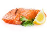 Grilled salmon with lemon on white background — Stock Photo