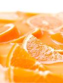 Plasterki pomarańczy soku. owoc — Zdjęcie stockowe