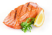 Grilled salmon with lemon isolated on white — Stock Photo