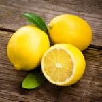 Fresh organic fruit - lemons on wood background selective focus — Stock Photo
