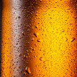 Beer. Texture of water drops on the bottle — Stock Photo