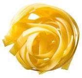 Tagliatelle pasta isolerade över vit bakgrund. — Stockfoto
