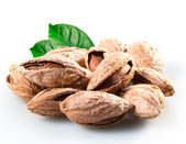 Almond. Group of nuts in kernel with leaves. Isolated on a white — Stock Photo