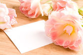 Bouquet of tulips with blank card — Stock Photo