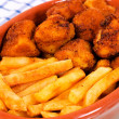 Chicken balls and french fries - Stock Photo