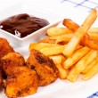 Chicken and french fries - Stock Photo