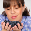 Smelling grapes — Stock Photo #13369957