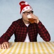 Santa and beer — Stock Photo