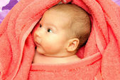 Baby in a towel — Stock Photo