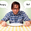 Hungry and sad - Stock Photo