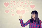 Female touching the heart — Stock Photo