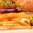 French fries and burgers — Stock Photo