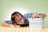 Drowsiness on books — Stock Photo