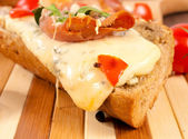 Melted cheese on sandwich — Stock Photo