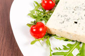 Blue cheese and cherry tomato — Stock Photo