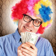 Clown with money — Stock Photo