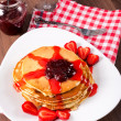 Strawberries jam and homemade pancakes — Stock Photo