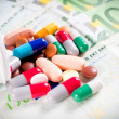 Pills on the money — Stock Photo