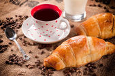 Fresh croissant and coffee — Stock Photo