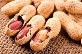 Three peanuts — Stock Photo