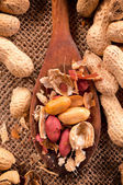 Peanuts on ladle — Stock Photo