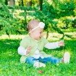 Baby taking dandelion — Stock Photo