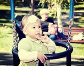 Baby on swing — Stock Photo