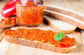 Ajvar on the bread — Stock Photo
