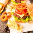 Onion rings and burger — Stock Photo