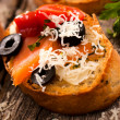 Salmon bruschetta — Stock Photo