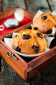 Muffins in the old box — Stock Photo