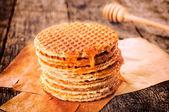 Honey and pancakes — Stock Photo