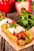 Cheese and vegetables on bread — Stock Photo