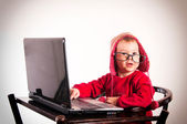 Surprised baby with laptop — Stock Photo