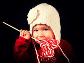 Baby with lolly pop — Stock Photo
