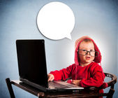 Child with laptop computer — Stock Photo