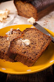 Banana bread and butter on plate — Stock Photo