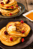 Honey and butter pancakes — Stock Photo