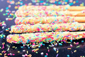 Sticks with colorful crumbs — Stock Photo