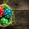 Dotted easter egg in basket — Stockfoto