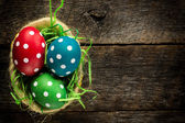 Dotted easter egg in basket — Stock Photo