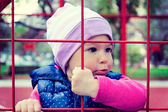 Child behind net — Stock Photo