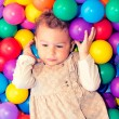 Child with colorful balls — Stock Photo
